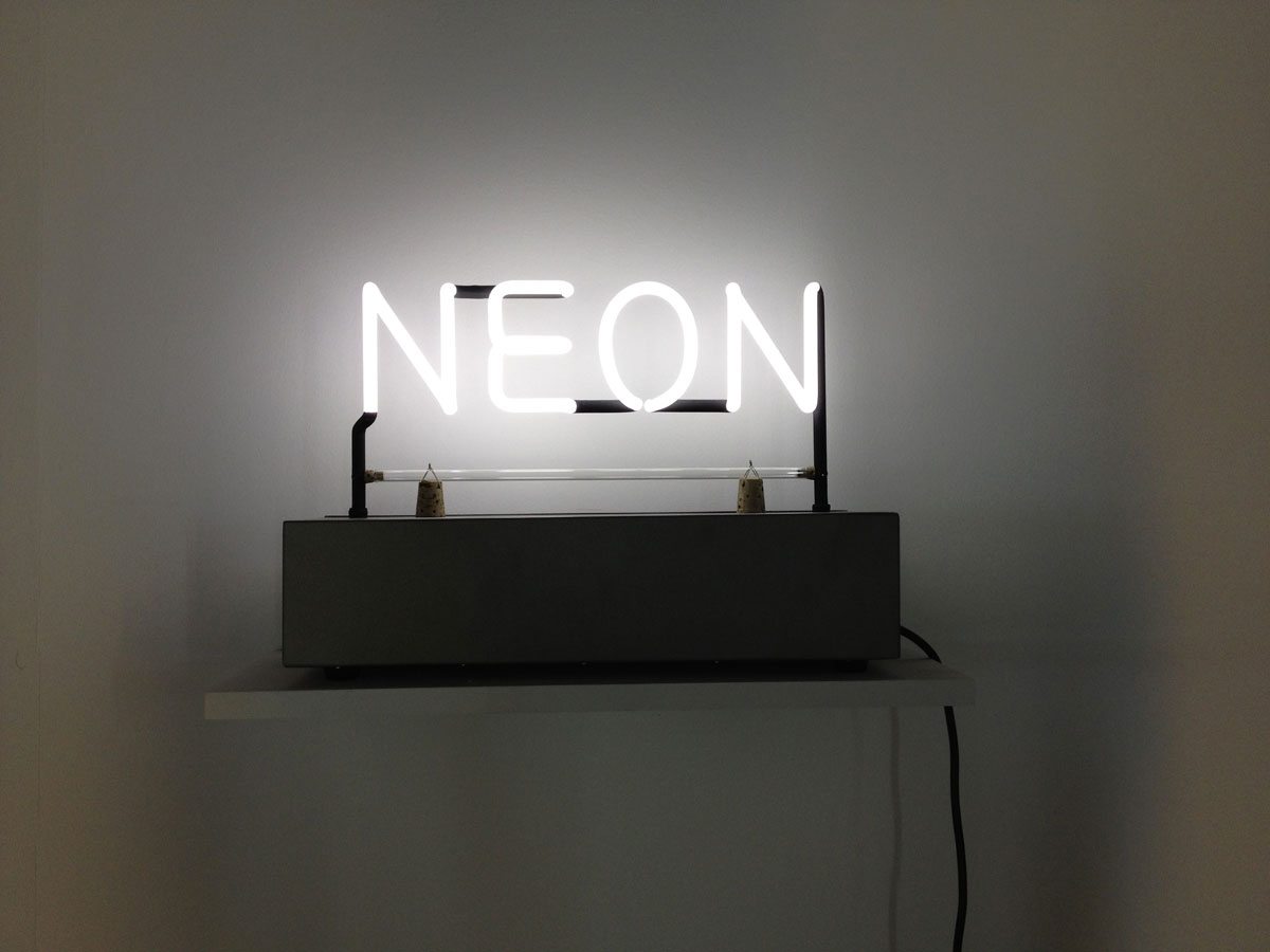 Joseph Kosuth 'Neon, 1965'. Macro contemporary art museum, Rome, Italy. Group show 'Neon, la materia luminosa dell'arte' curated by Bartolomeo Pietromarchi and David Rosenberg, June-November 2012. White neon, metal box, cork. Production and installation: Neonlauro, June 2012.
