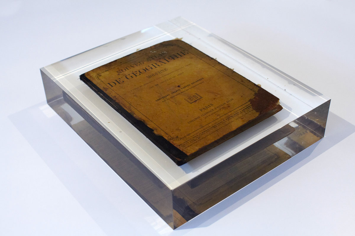 Ali Cherri. Imane Fares gallery, Paris, France. Ancient book drowned in plexiglass. Production: Neonlauro, February 2014.
